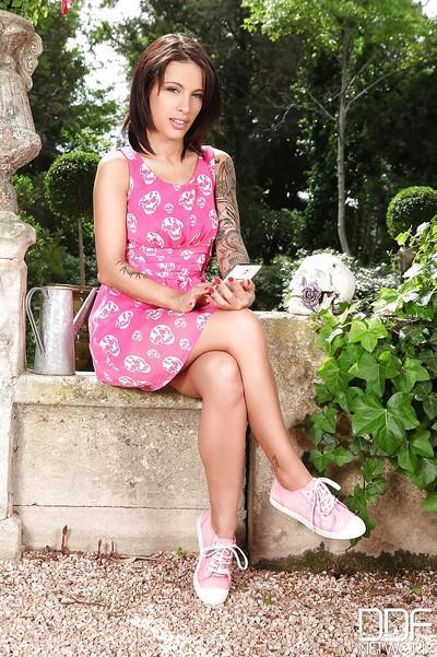 Brunette milf Nikita Bellucci is showing off outdoor in her pink dress