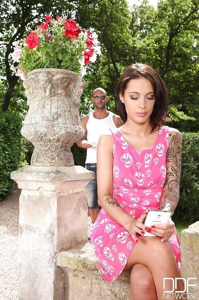 Brunette milf Nikita Bellucci is showing off outdoor in her pink dress