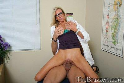 Busty Emma Starr in glasses has her cunt licked and fucked hardcore