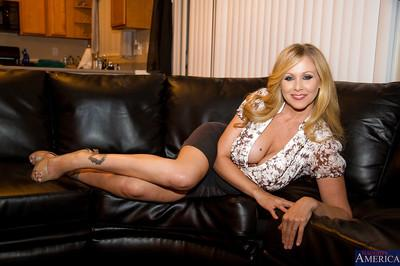 Gorgeous wife Julia Ann is demonstrating her big tits in high heels