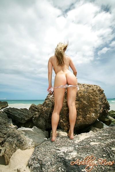 Blonde beach babe Ashley Fires modeling topless in bikini bottoms