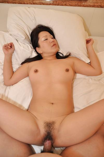 Asian MILF Kumiko Katsura gives a sensual blowjob and gets fucked