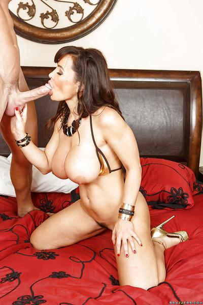Brunette cougar Lisa Ann is sucking big cock and is fucked with it hard