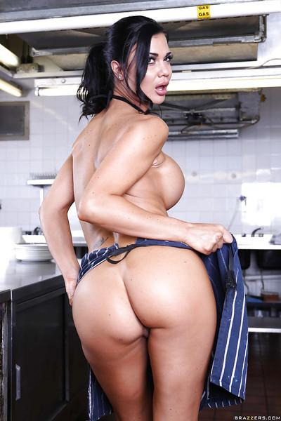 Steamy brunette MILF exposing her huge shapely jugs and amazing booty