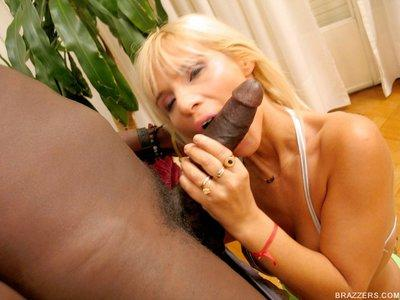 Busty MILF babe Laura has rough interracial sex with a big dick