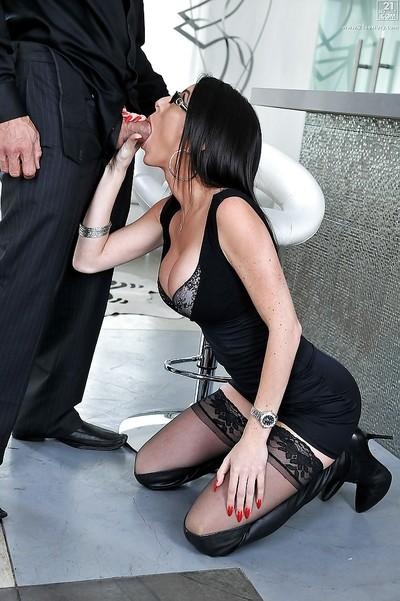 Tall and nerdy brunette in over the knee leather boots jacking cock