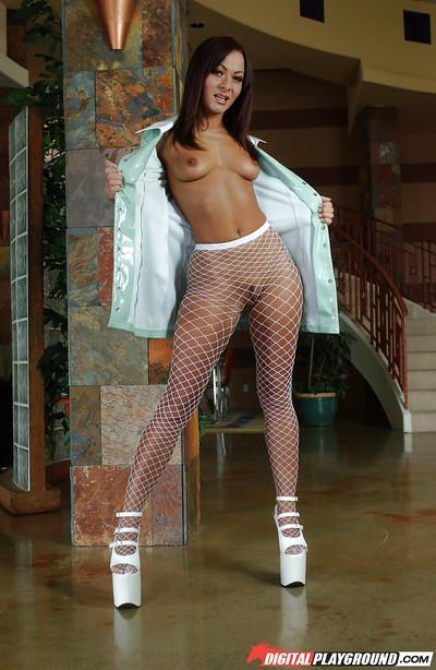 Sultry MILF Sandra Romain posing in hot mesh stockings and high heels