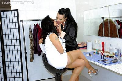 Fully clothed babe Carmen Croft having lesbian fun with her sexy friend