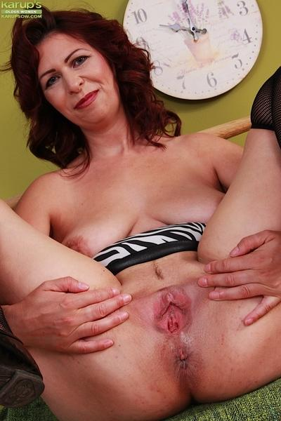 Busty older MILF Laila Fereschte letting big natural boobs free from dress