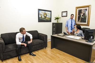 Tory Lane is into double penetration action with her well-hung office mates