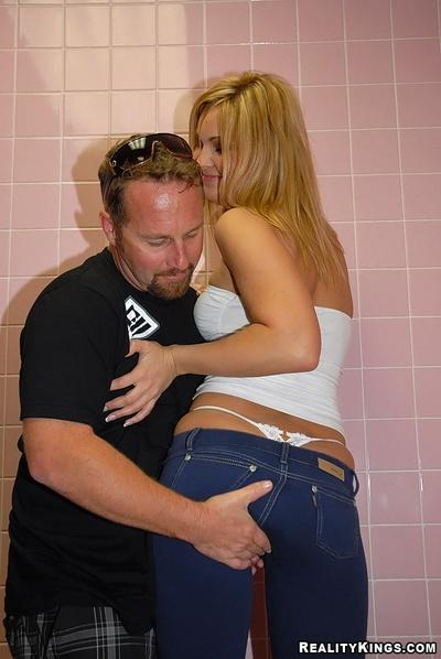 Fresh busty milf in tight jeans gets fucked in public toilet