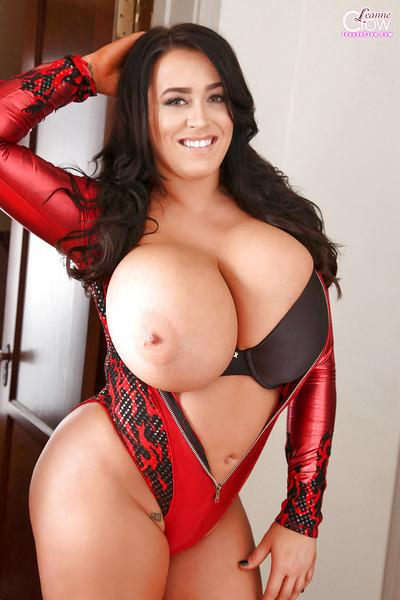 Big-tit babe Leanne Crow poses topless in her latex suite in close-up