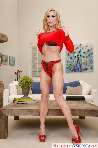 Leggy blonde mom Amber Lynn flaunting large boobs in high heels