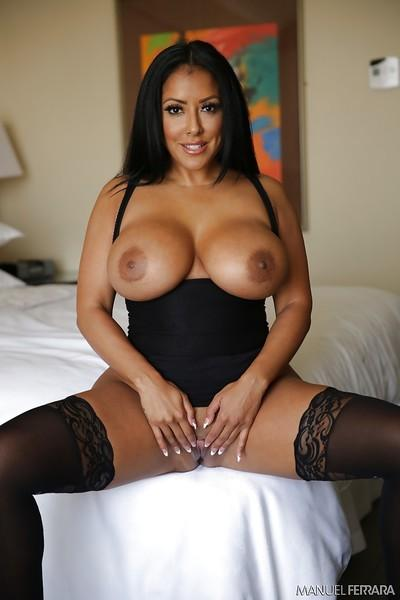 Chesty Latina MILF Kiara Mia letting huge knockers loose from dress