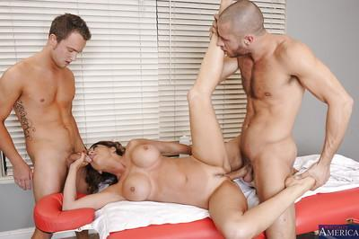 Salacious MILF with big round tits has some fun with two stiff cocks