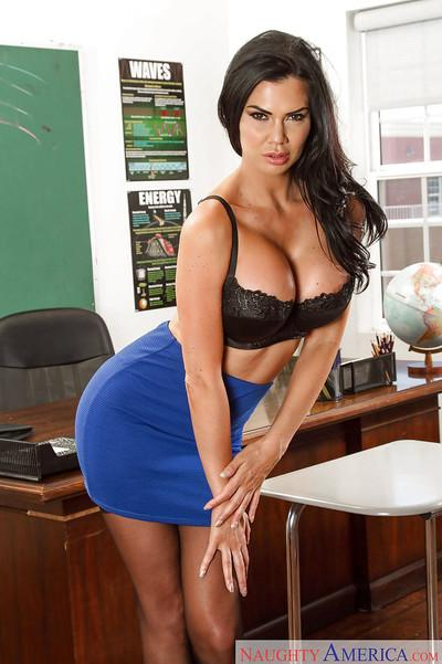 Slutty MILF Jasmine Jae pulling out her big boobs in stockings