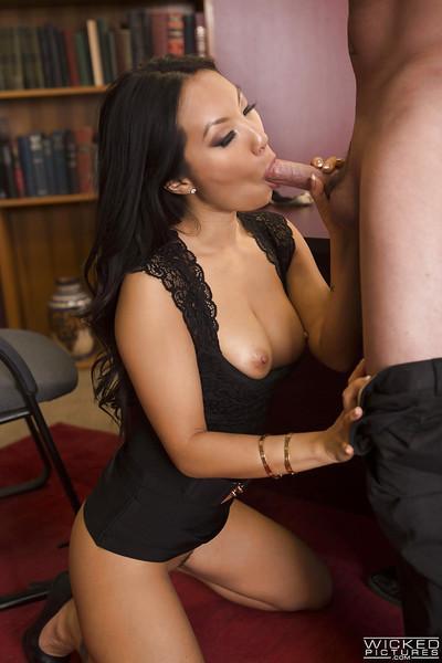 Asian MILF pornstar Asa Akira giving long dick a blowjob on her knees