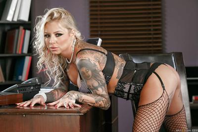 Chesty blonde boss woman Britney Shannon modeling fishnet stockings at work