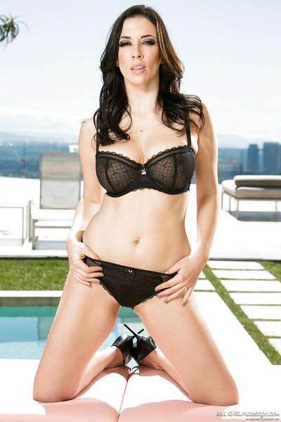 Tall brunette solo babe Jelena Jensen posing outdoors in lingerie