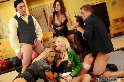 Kinky pornstars enjoy a hardcore groupsex and golden shower