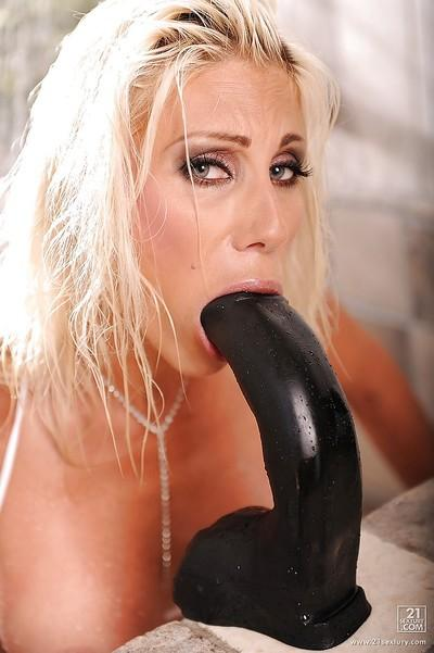 Big busted MILF in bikini Puma Swede playing with a huge black toy