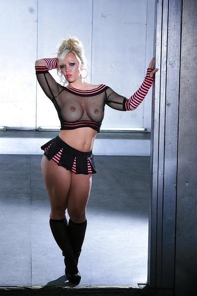 Curvy blonde MILF on high heels performs a steamy striptease