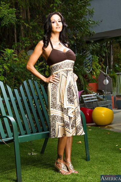 Brunette milf Ava Addams is posing outdoor in her sexy long dress