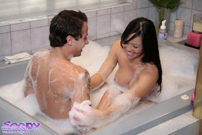Curvaceous asian masseuse gives a proper soapy handjob treatment