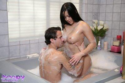 Curvaceous asian masseuse gives a proper soapy handjob treatment