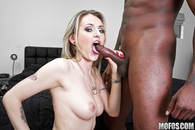 Salacious MILF blows and fucks a black meaty pole for jizz in her eager mouth