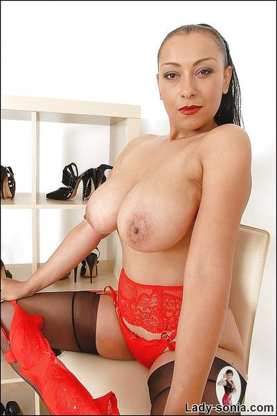 Curvy fetish minx in lingerie and stockings uncovering her big tits