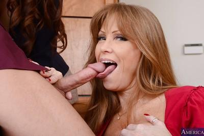 Big tit and ass office milfs giving a double blowjob to that guy