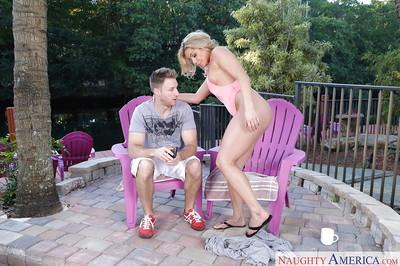 Blonde cougar Nikki Capone seducing younger man for sex outdoors