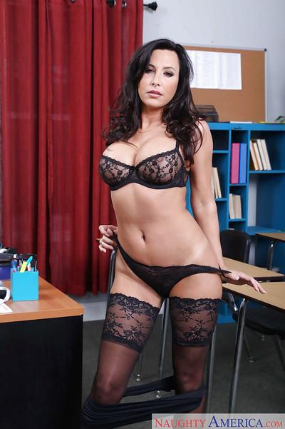 Brunette MILF teacher Lezley Zen poses topless in classroom