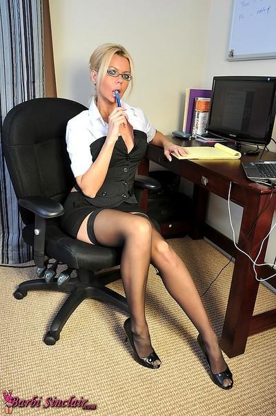 Classy MILF secretary shows off her wonderful body wearing black stockings in her office.