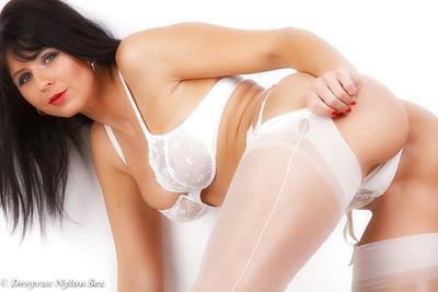 Beautiful brunette MILF Desyra Noir undressing after having smoke