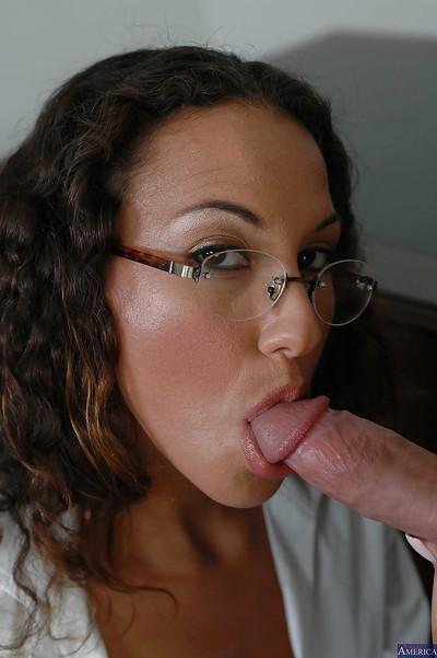 Curly-haired teacher Adriana Deville is standing and sucking dick