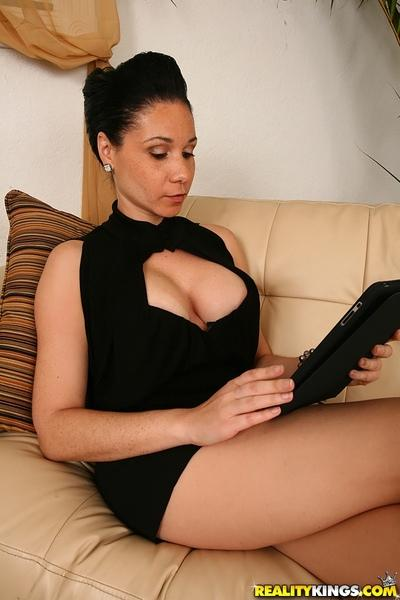 Big titted latin MILF Tacori Blu showing her seductive cleavage