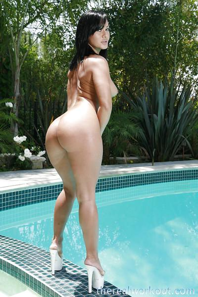 Seductive latina babe Sandra Romain posing naked by the pool