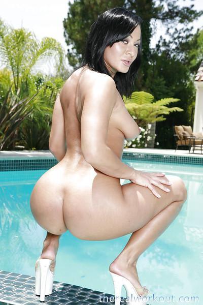 Seductive latina babe Sandra Romain posing naked by the pool