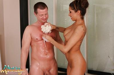 Juggy latina masseuse has some wet and soapy fun with her hung client