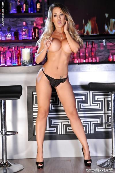 Blonde Italian mommy Capri Cavalli removing little black dress to bare tits