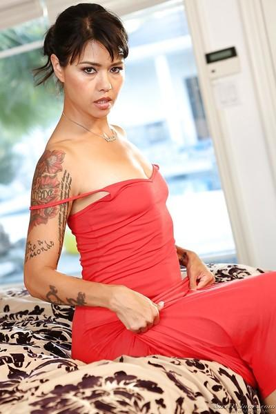 Tattooed pornstar Dana Vespoli slipping off her dress and panties