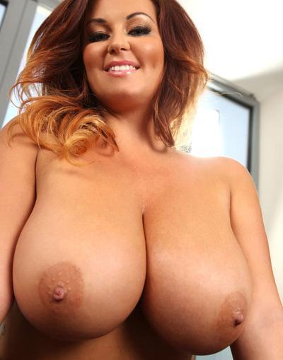 Redhead pornstar with big boobies Sarah Nicola Randall shows herself