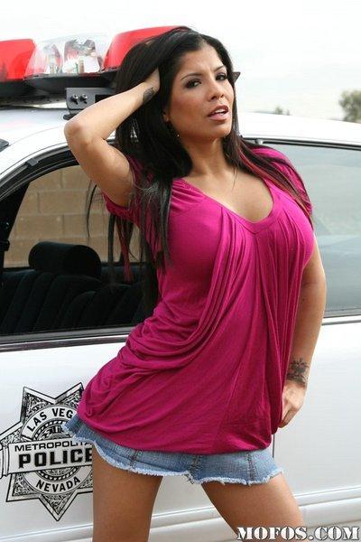 So fuckin hot milf with wonderful ass posing outdoor near police car
