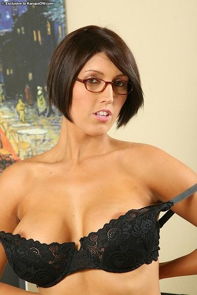 Frisky vixen in glasses undressing and exposing her gorgeous tits in close up