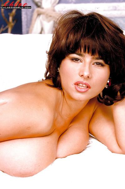 Stocking attired MILF Chloe Vevrier unveils huge hooters and beaver