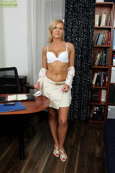 Stunning milf Carrie loves masturbating in her office while she is alone