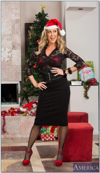 Hot MILF in stockings Brandi Love slipping off her suit and lingerie
