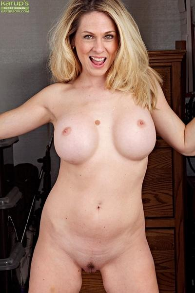 Horny blonde MILF Angela Attison showing off her big boobs and cunt